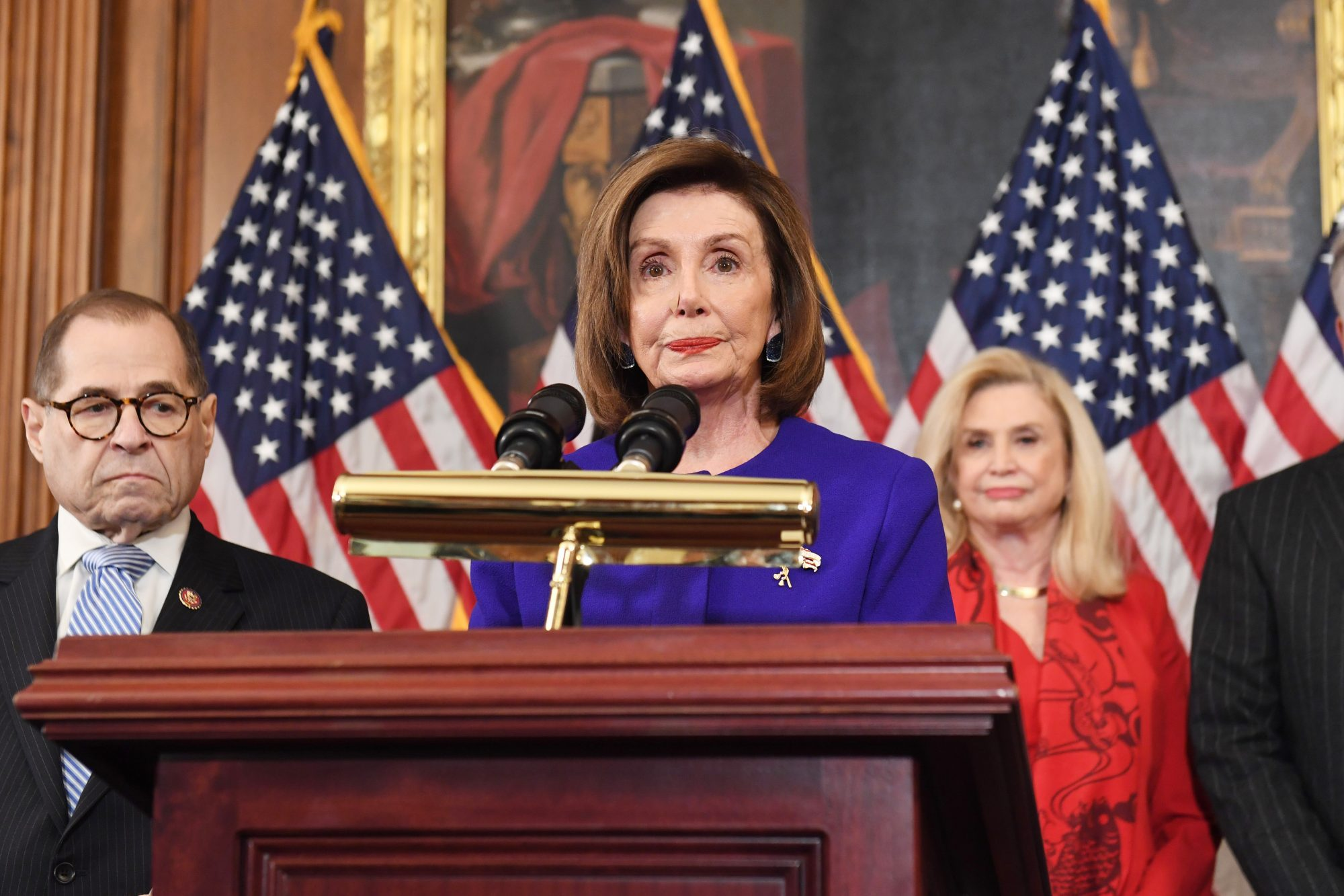 House Speaker Nancy Pelosi (D-CA) speaks next to House Judiciary Chairman Jerry Nadler(L), Democrat of New York, House Permanent Select Committee on Intelligence as they announce articles of impeachment for US President Donald Trump during a press conference at the US Capitol in Washington, DC, December 10, 2019. (Photo by SAUL LOEB / AFP) (Photo by SAUL LOEB/AFP via Getty Images)