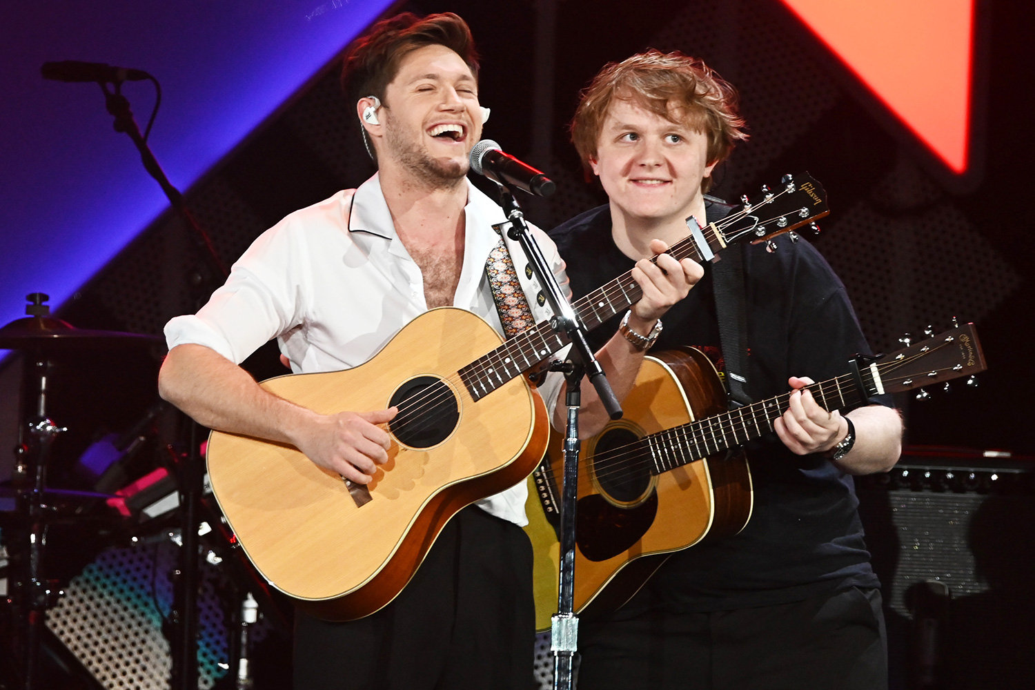 Niall Horan and Lewis Capaldi perform during 103.5 KISS FM's Jingle Ball 2019 - Show on December 18, 2019 in Chicago, Illinois