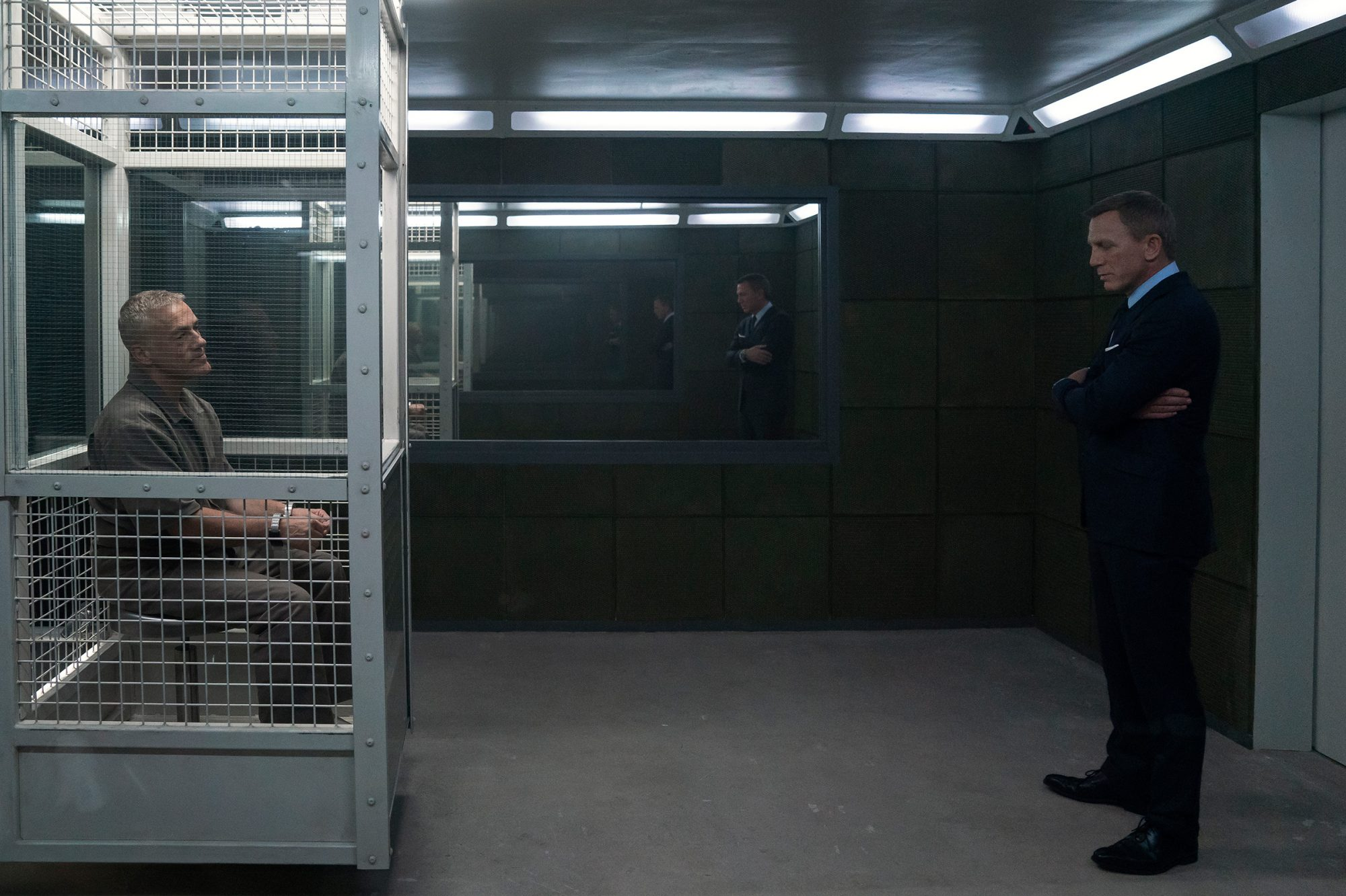 James Bond (Daniel Craig) visits Blofeld (Christoph Waltz) in his prison cell in NO TIME TO DIE, a DANJAQ and Metro Goldwyn Mayer Pictures film