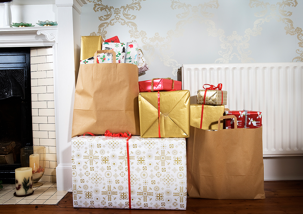 Presents in shopping bags in living room. holiday gifts; presents; packages