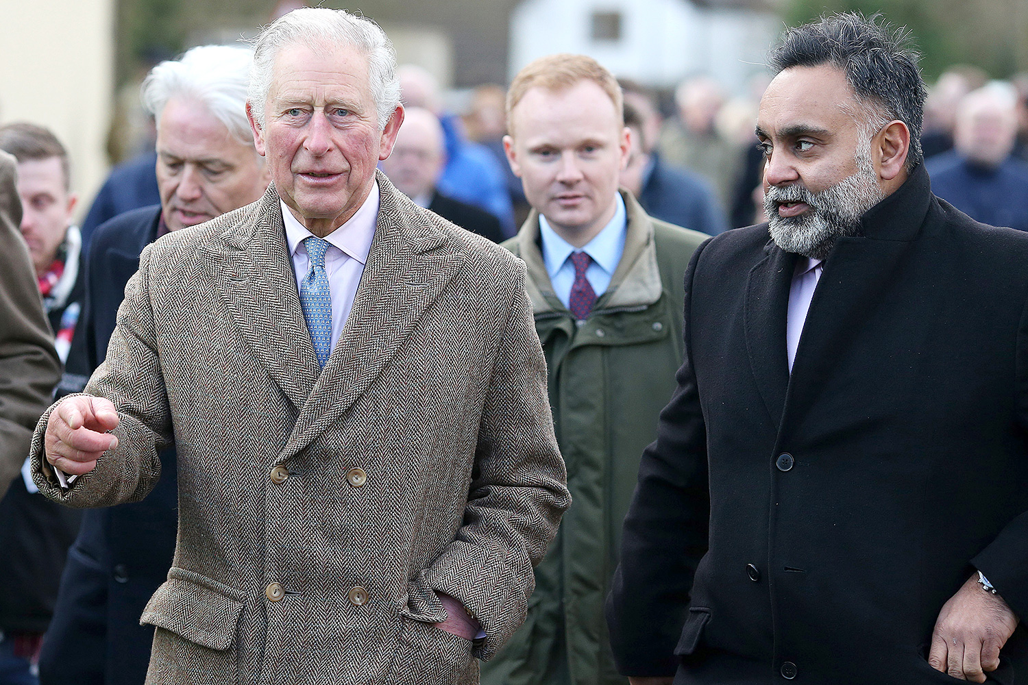 Prince Charles, Prince Of Wales tours the village of Fishlake during a visit to South Yorkshire which was hit by floods earlier this year, on December 23, 2019 in Fishlake, South Yorkshire