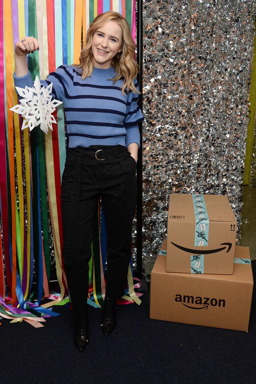 Rachel Brosnahan joins Amazon in Delivering Smiles this holiday season at Covenant House New York.