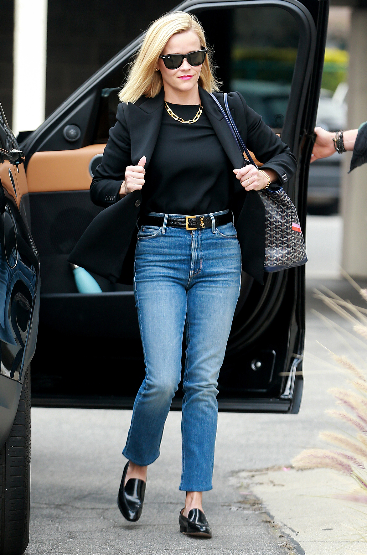 Reese Witherspoon is all smiles as she heads to a business meeting in Los Angeles.