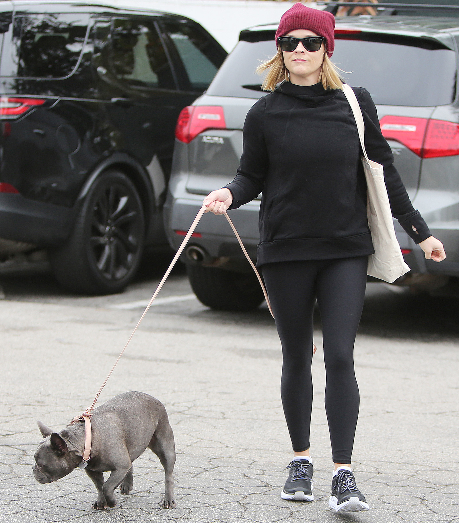 Reese Witherspoon goes shopping with her dog in Brentwood. Reese Witherspoon out and about, Los Angeles, USA - 08 Dec 2019