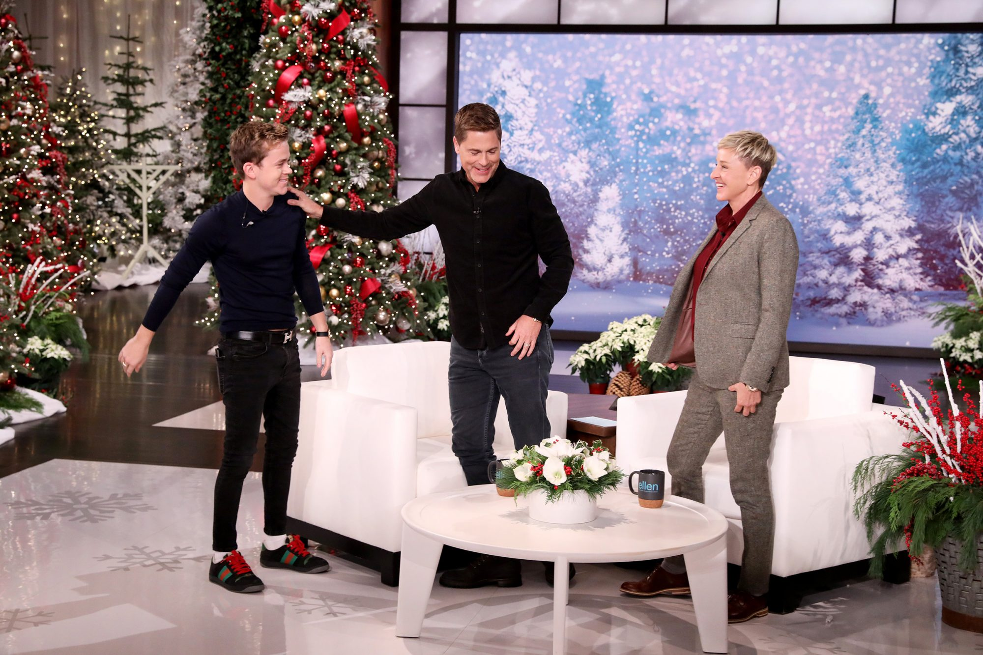 """Holiday in the Wild"" star Rob Lowe makes an appearance on ""The Ellen DeGeneres Show"" airing Monday, December 2nd, and talks about how Ellen convinced him to buy her Porsche. Rob gushes about his sons John Owen, who is writing for Ryan Murphy, and Matthew, who just passed the California bar exam."