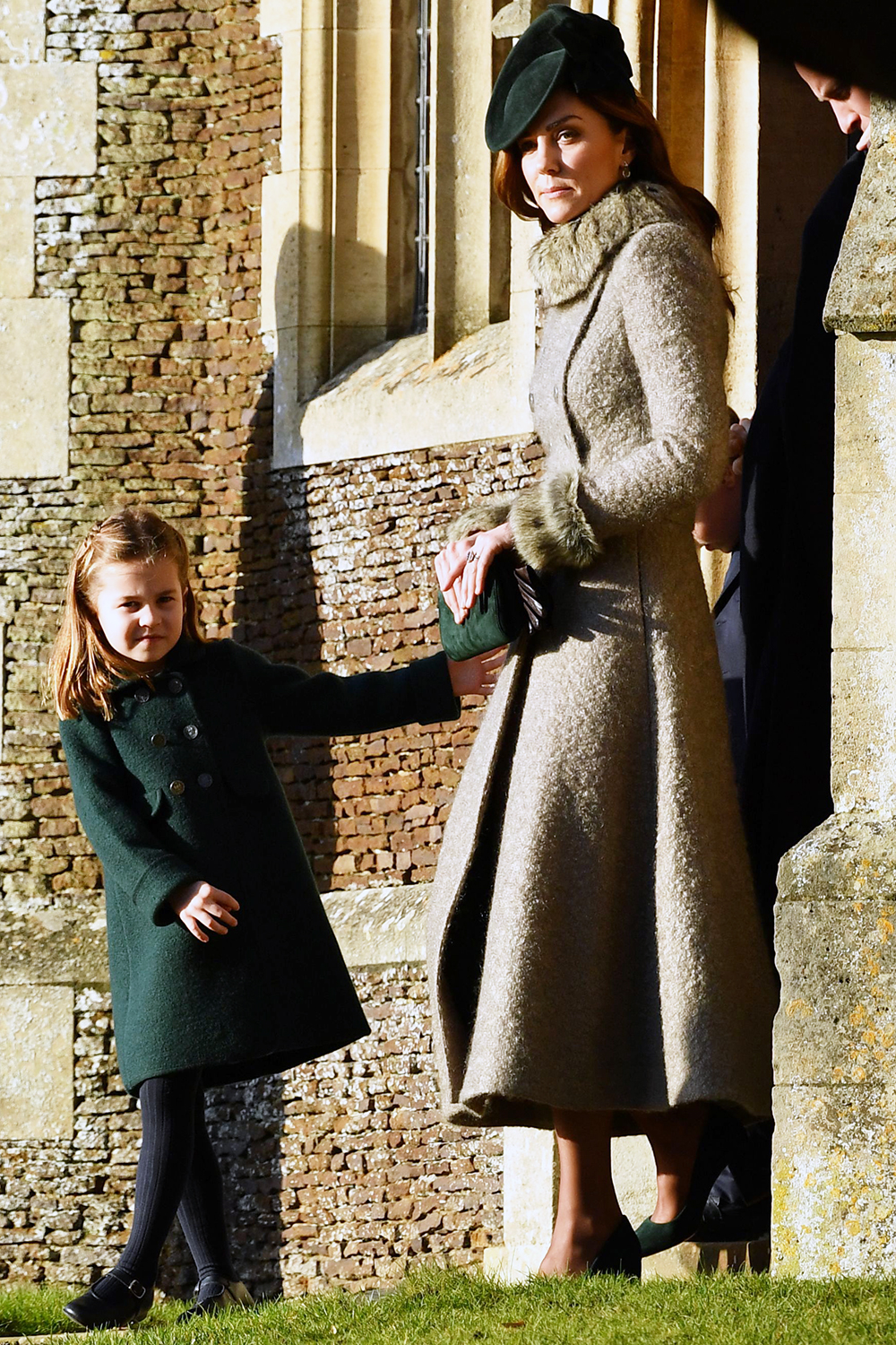 Britain's Princess Charlotte of Cambridge (L) and Britain's Catherine, Duchess of Cambridge leave after the Royal Family's traditional Christmas Day service at St Mary Magdalene Church in Sandringham, Norfolk, eastern England, on December 25, 2019. (Photo by Ben STANSALL / AFP) (Photo by BEN STANSALL/AFP via Getty Images)