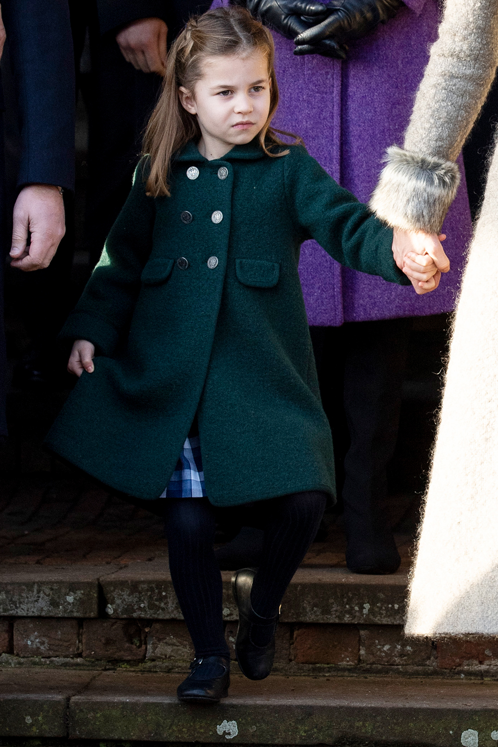 KING'S LYNN, ENGLAND - DECEMBER 25: Princess Charlotte of Cambridge attempts a curtsey to the Queen at the Christmas Day Church service at Church of St Mary Magdalene on the Sandringham estate on December 25, 2019 in King's Lynn, United Kingdom. (Photo by Mark Cuthbert/UK Press via Getty Images)