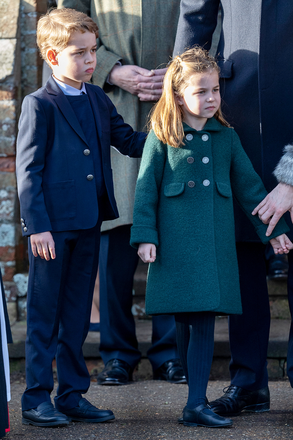 KING'S LYNN, ENGLAND - DECEMBER 25: Prince George of Cambridge and Princess Charlotte of Cambridge attend the Christmas Day Church service at Church of St Mary Magdalene on the Sandringham estate on December 25, 2019 in King's Lynn, United Kingdom. (Photo by Mark Cuthbert/UK Press via Getty Images)
