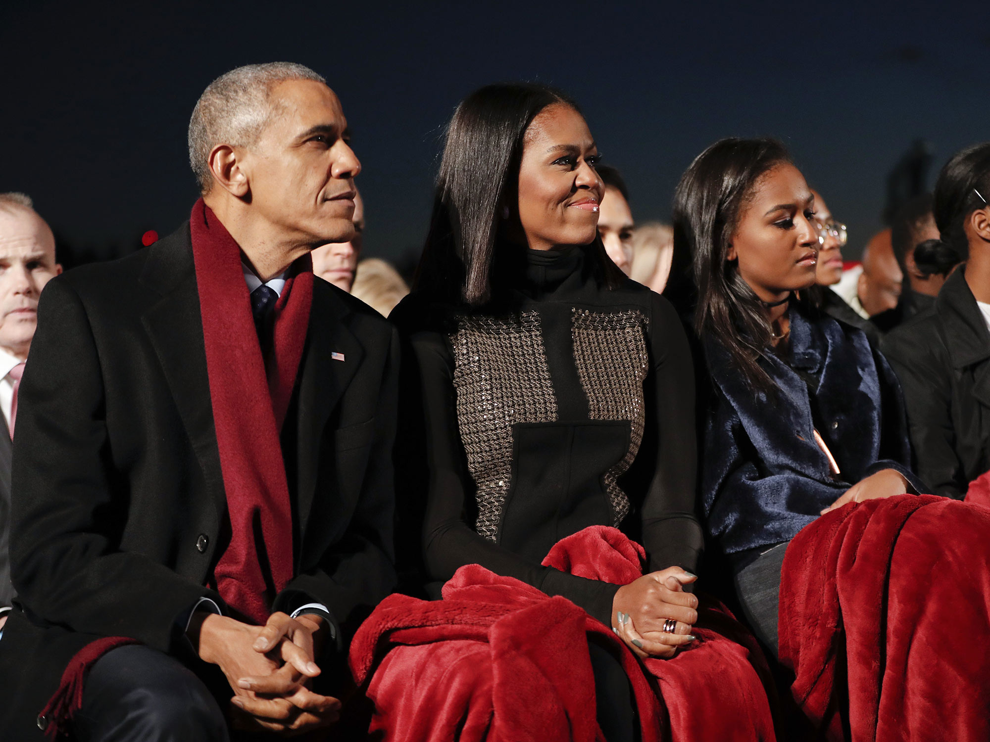 President Barack Obama, sits with first lady Michelle Obama, center, and their daughter Sasha, right, to watch the musical performances at the lighting the 2016 National Christmas Tree ceremony at the Ellipse near the White House in Washington, Thursday, Dec. 1, 2016. (AP Photo/Pablo Martinez Monsivais)