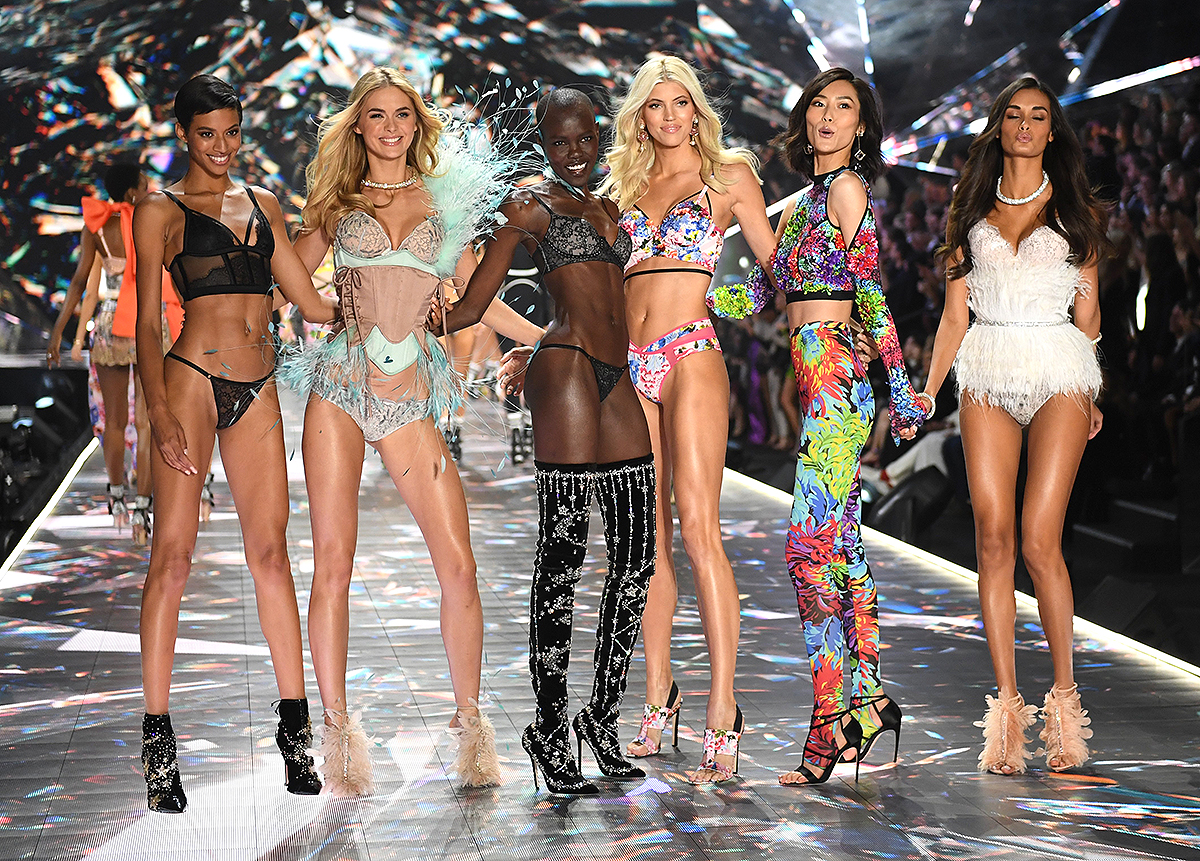 (FromL) Models Jourdana Phillips, Megan Williams, Grace Bol, Devon Windsor, Liu Wen, and Gizele Oliveira walk the runway at the 2018 Victoria's Secret Fashion Show on November 8, 2018 at Pier 94 in New York City. - Every year, the Victoria's Secret show brings its famous models together for what is consistently a glittery catwalk extravaganza. It's the most-watched fashion event of the year (800 million tune in annually) with around 12 million USD spent on putting the spectacle together according to Harper's Bazaar.