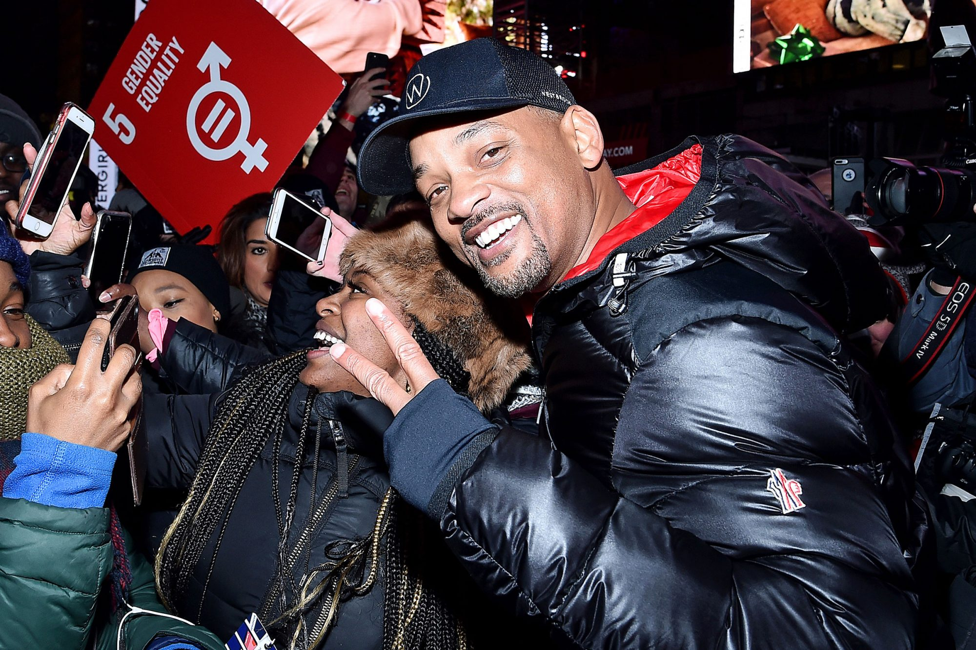 Will Smith takes selfies with participants during the The World's Big Sleep Out at Times Square on December 07, 2019 in New York City