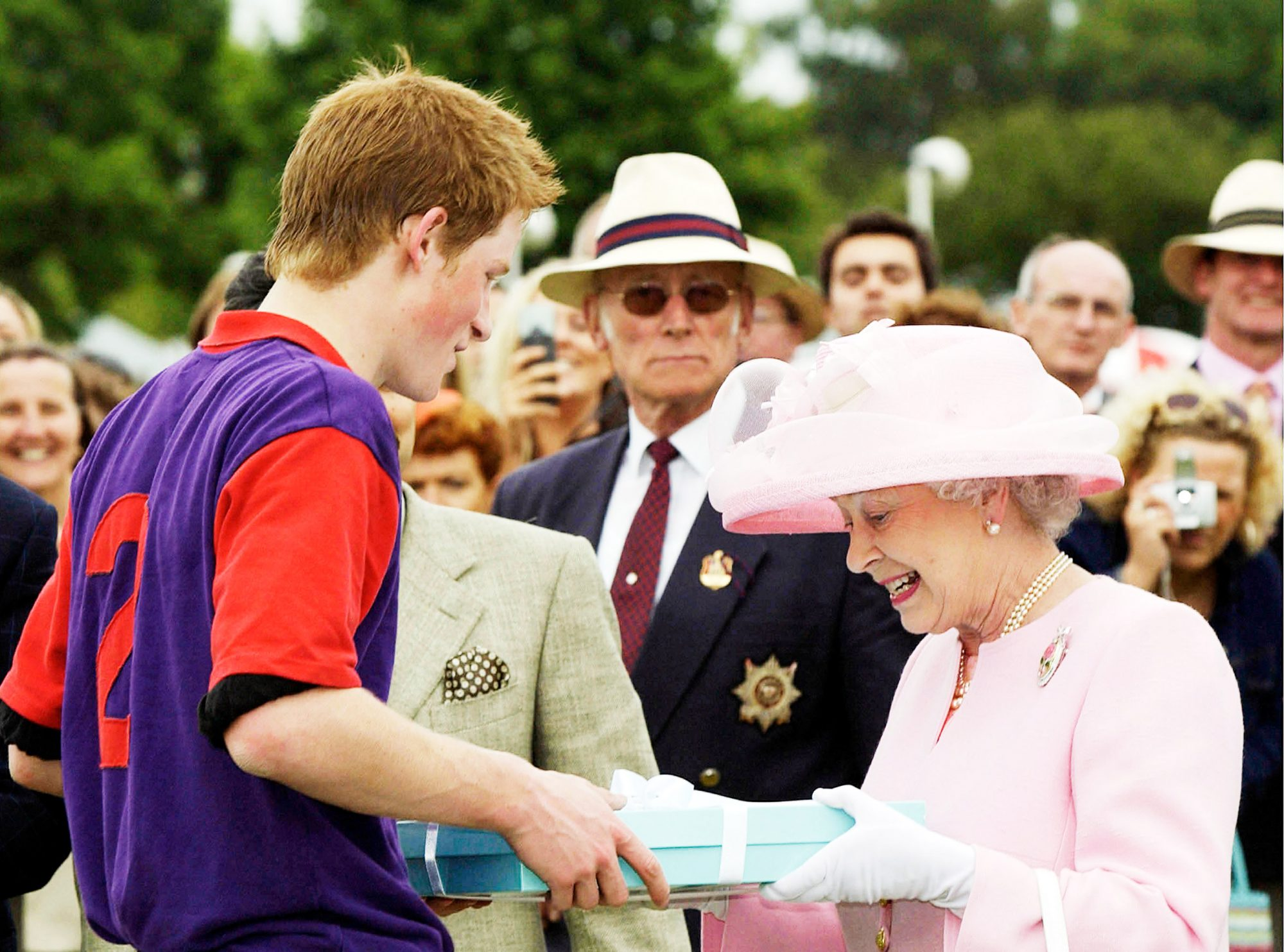 GBR: Queen Elizabeth II makes a presentation to Prince Harry at Royal Ascot