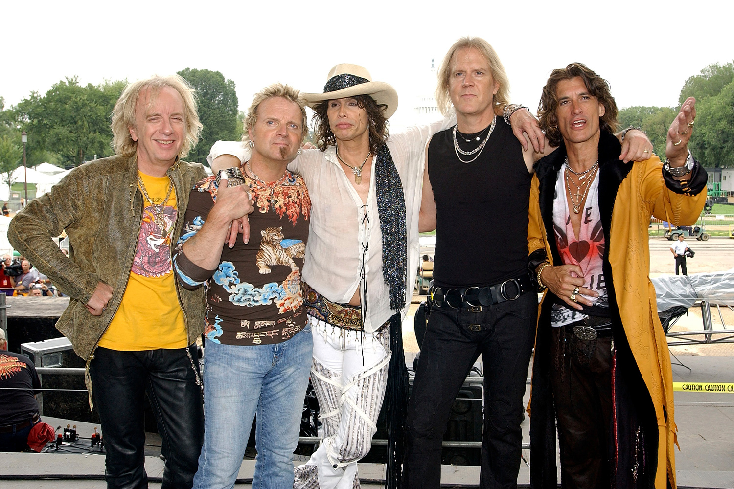 "Rock band Aerosmith poses for a photo after they rehearsed for the 2003 ""NFL Kickoff Live from the National Mall"" September 4, 2003 in Washington, DC"