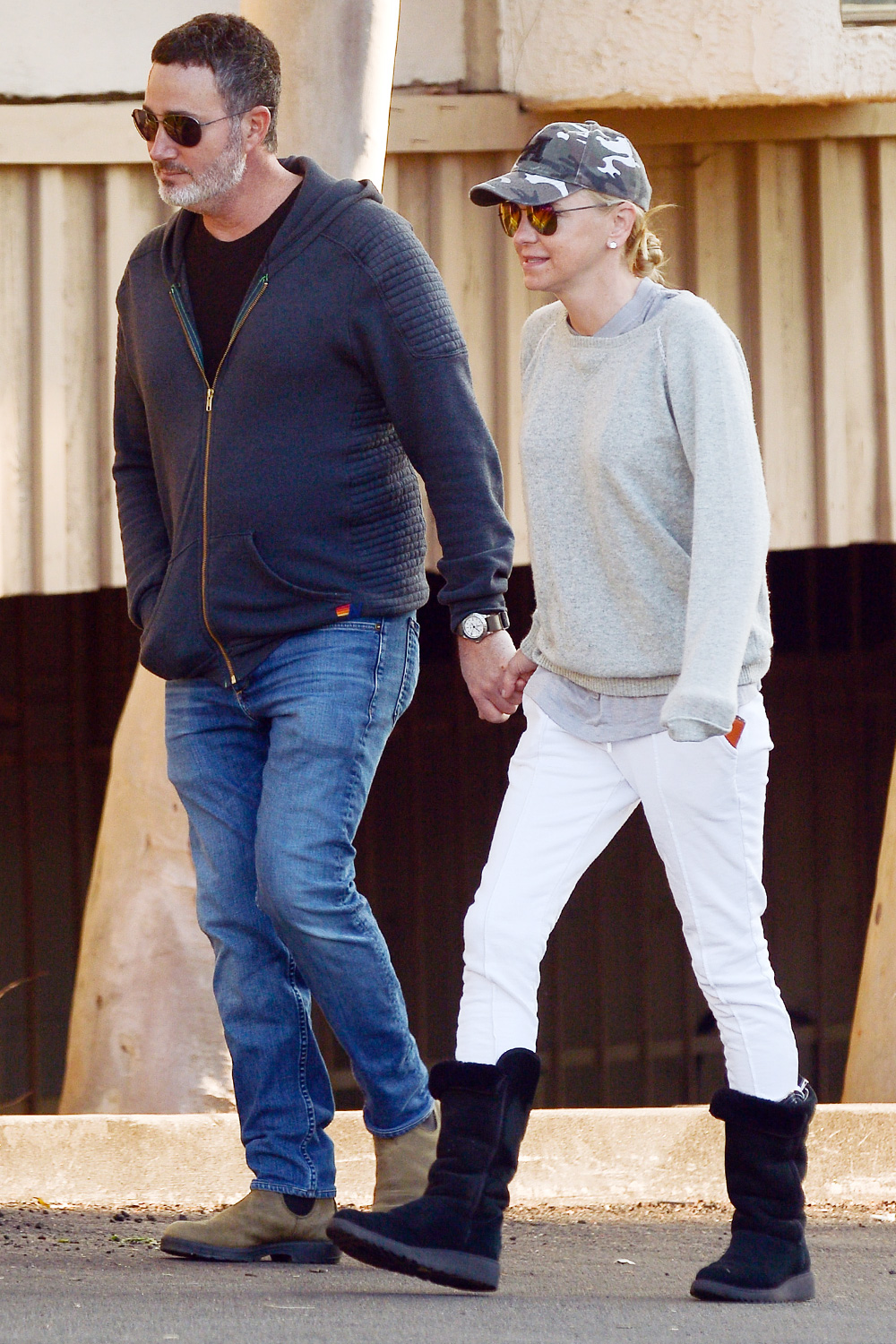 Anna Faris and fiance Michael Barrett are pictured holding hands while on stroll in Los Angeles