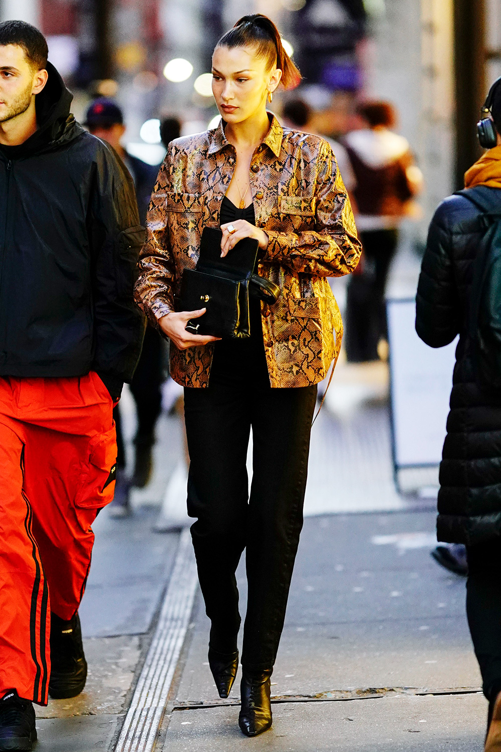 Bella Hadid out and about wearing a snakeskin jacket in New York