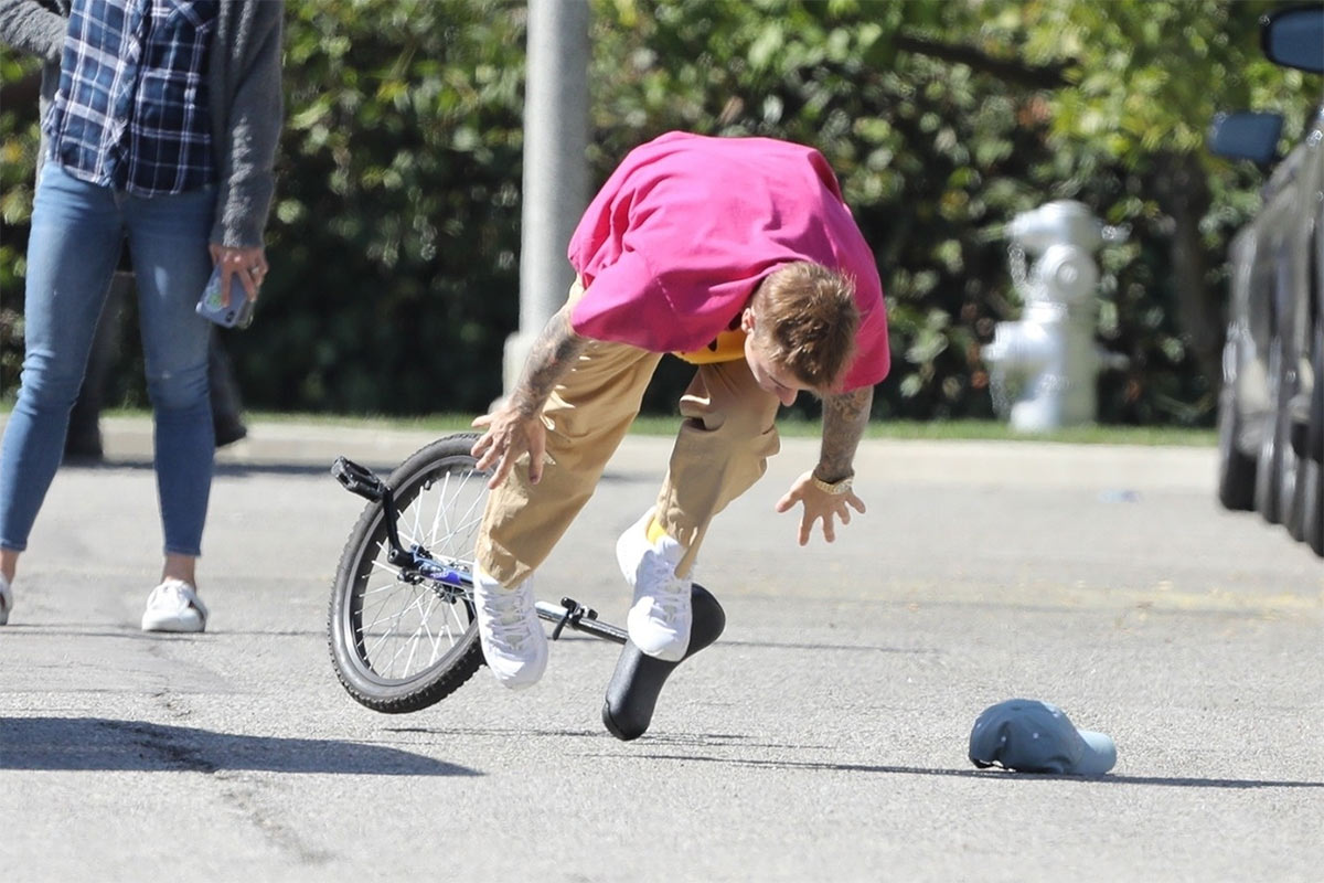 Justin Bieber falls off unicycle