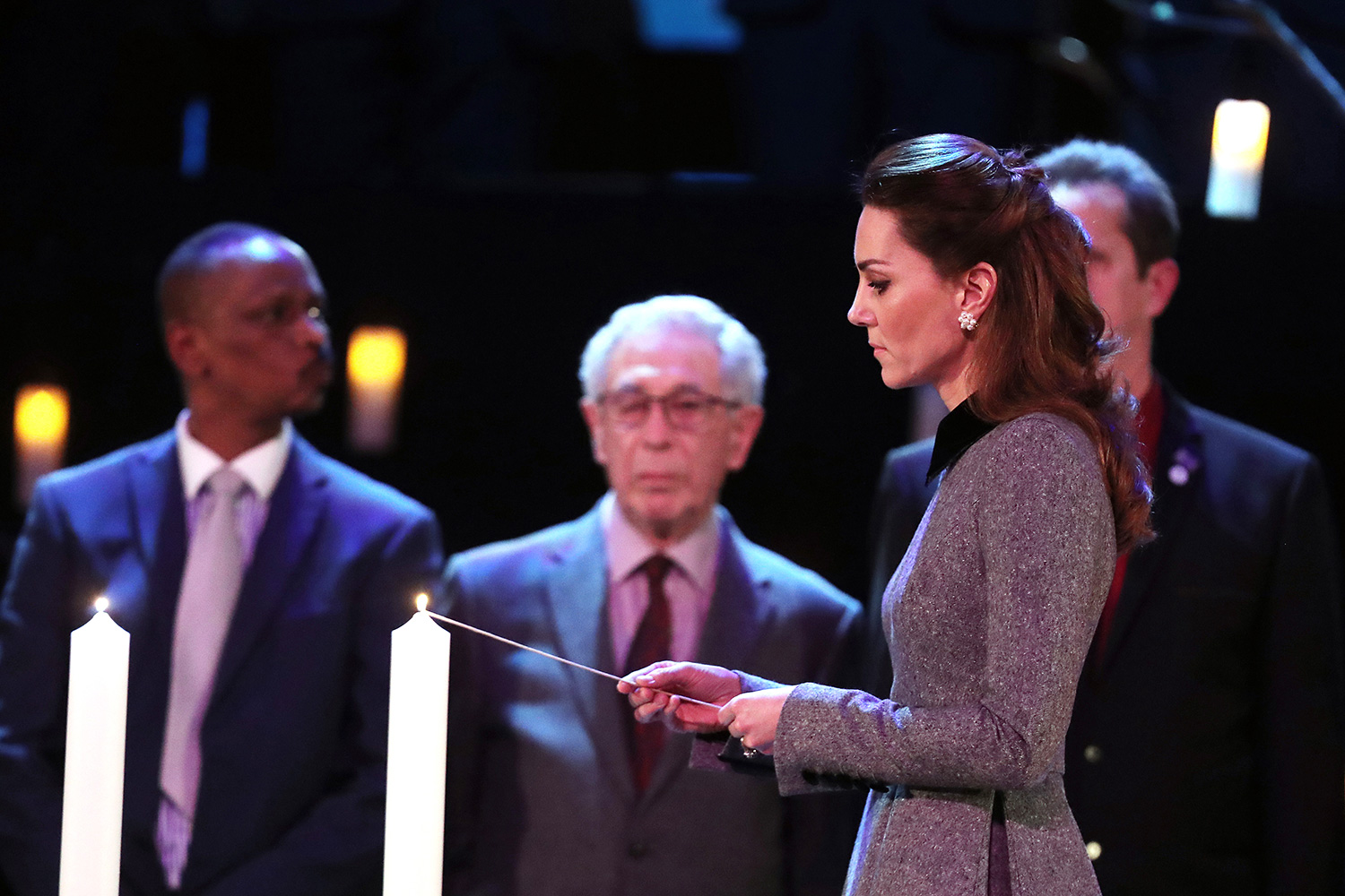 Catherine, Duchess of Cambridge lights a candle during the UK Holocaust Memorial Day Commemorative Ceremony in Westminster on January 27, 2020 in London
