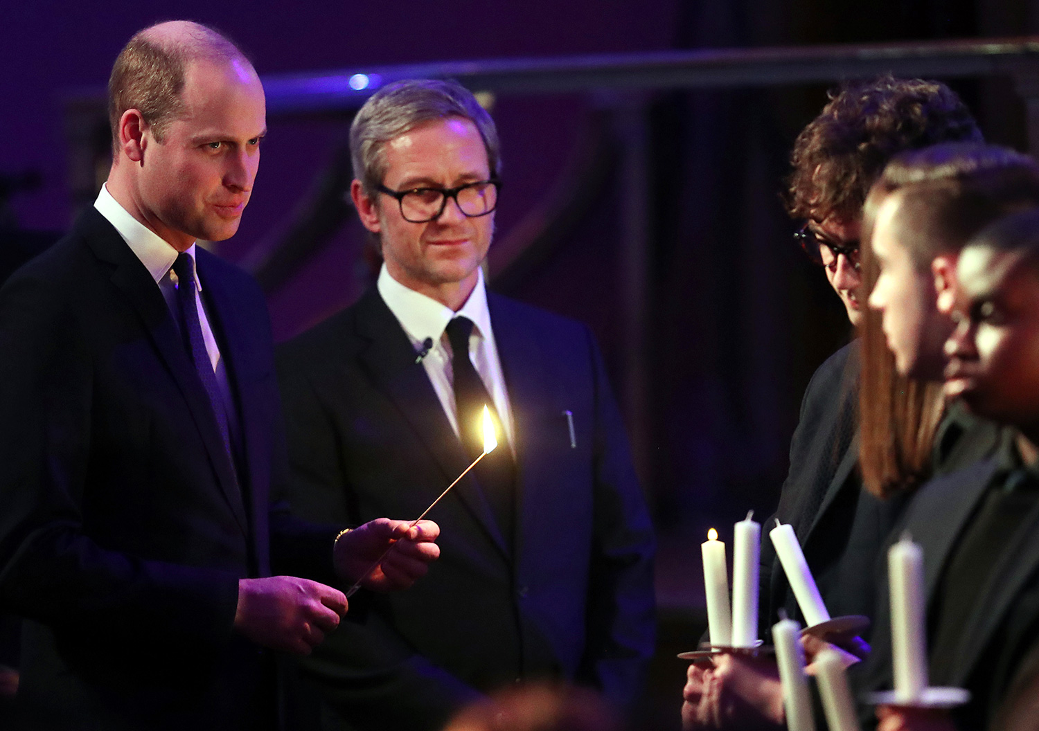 Prince William, Duke of Cambridge lights a candle during the UK Holocaust Memorial Day Commemorative Ceremony in Westminster on January 27, 2020 in London