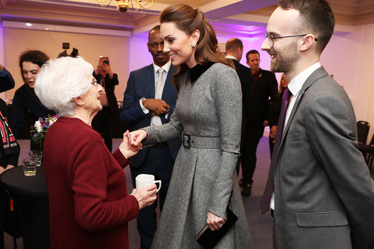 Catherine, Duchess of Cambridge shares a joke with Holocaust survivor Yvonne Bernstein after the UK Holocaust Memorial Day Commemorative Ceremony in Westminster on January 27, 2020 in London
