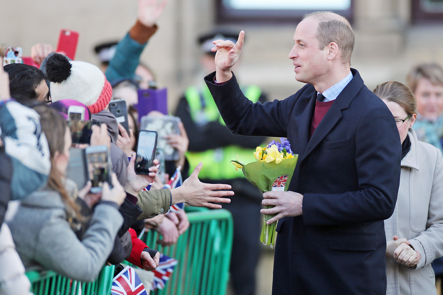 The Duke of Cambridge speaks to local people as he leaves after a visit to City Hall in Bradford to join a group of young people from across the community to hear about life in the city.