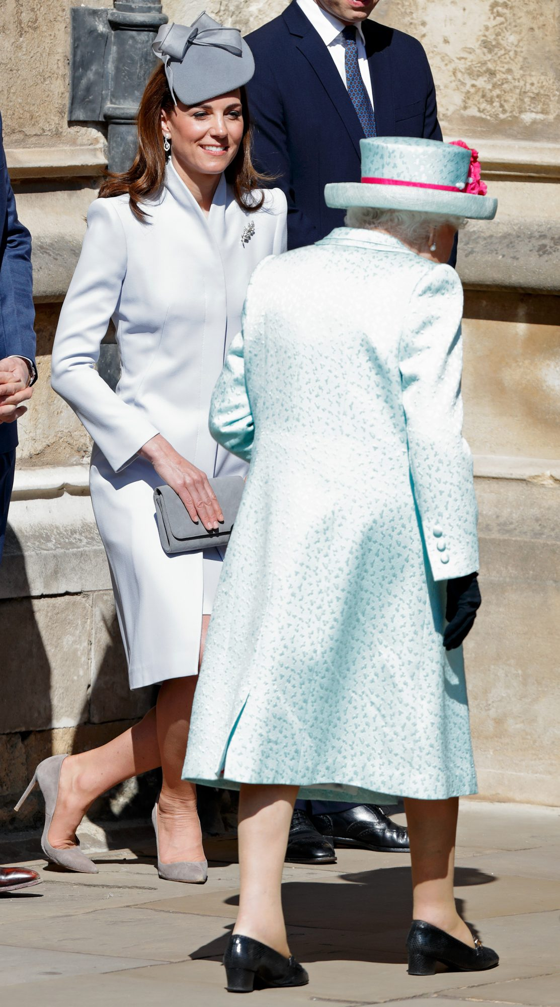 Catherine, Duchess of Cambridge curtsies to Queen Elizabeth II as they attend the traditional Easter Sunday church service at St George's Chapel, Windsor Castle on April 21, 2019 in Windsor