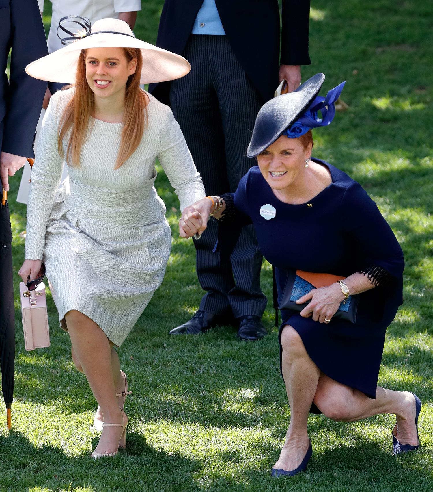 Princess Beatrice and Sarah, Duchess of York curtsy to Queen Elizabeth II as she and her guests pass by in horse drawn carriages on day 4 of Royal Ascot at Ascot Racecourse on June 22, 2018 in Ascot, England