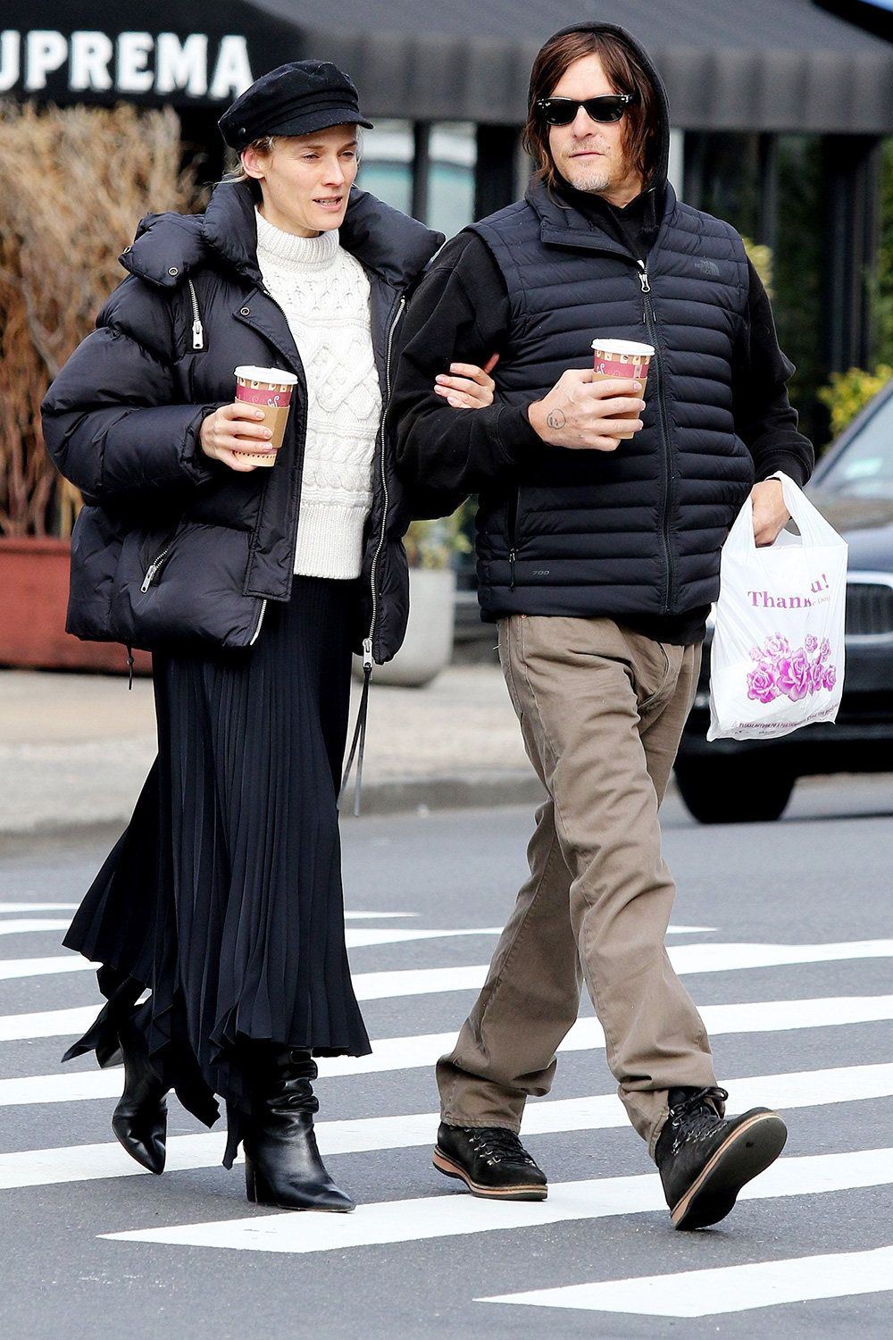 Diane Kruger and Norman Reedus walk arm-in-arm as they go for a morning coffee run in Manhattan's West Village area. 28 Jan 2020