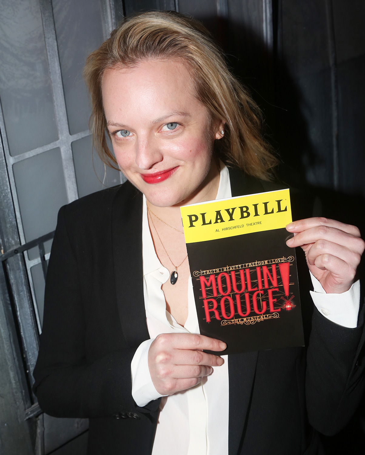 "Elisabeth Moss poses backstage at the hit musical based on the Baz Luhrmann film ""Moulin Rouge!"" on Broadway at The Al Hirshfeld Theatre on January 8, 2020 in New York City"