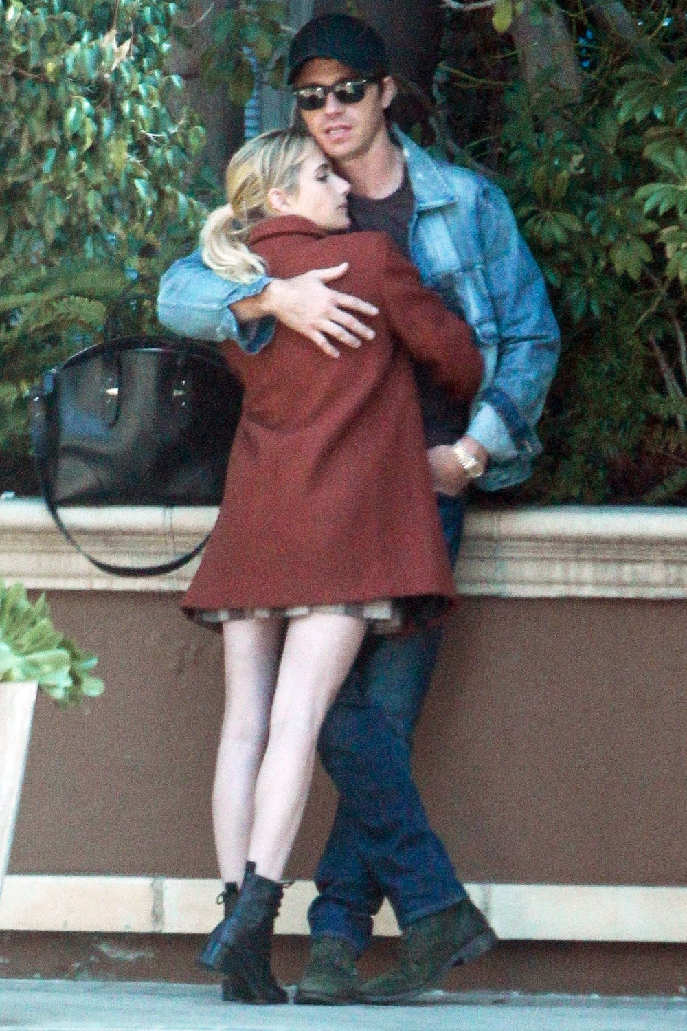 Emma Roberts and boyfriend Garrett Hedlund enjoys a smoke and share some PDA with our cameras after grabbing brunch at The Four Season Hotel