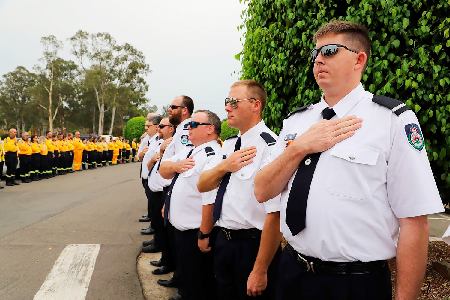 New South Wales Rural Fire Service crew watch as the casket of NSW RFS volunteer Andrew O'Dwyer arrives for his funeral service at Our Lady of Victories Catholic Church in Horsley Park, Sydney, . O'Dwyer, 36, and RFS colleague Geoffrey Keaton were killed six days before Christmas when a tree fell in the path of their truck at the still-burning Green Wattle Creek fire, causing it to roll Wildfires, Sydney, Australia - 07 Jan 2020