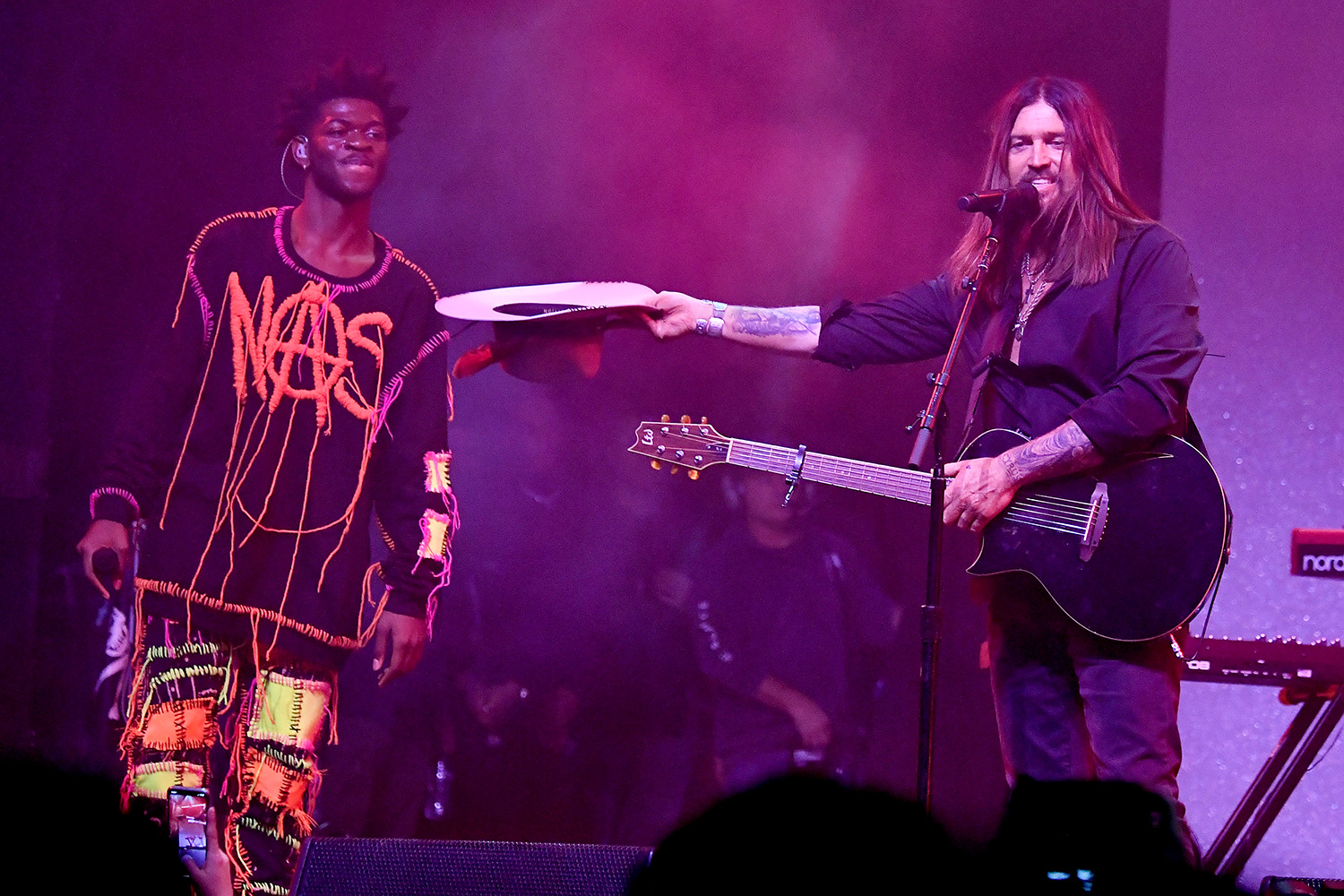 """Lil Nas X and Billy Ray Cyrus perform onstage during Spotify Hosts """"Best New Artist"""" Party at The Lot Studios on January 23, 2020 in Los Angeles, California"""