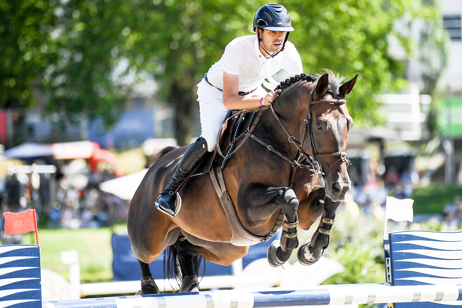 26 July 2019, Berlin: Equestrian sports/jumping: Global Champions Tour: Nayel Nassar on the horse Lucifer V jumps over an obstacle during the opening jump.