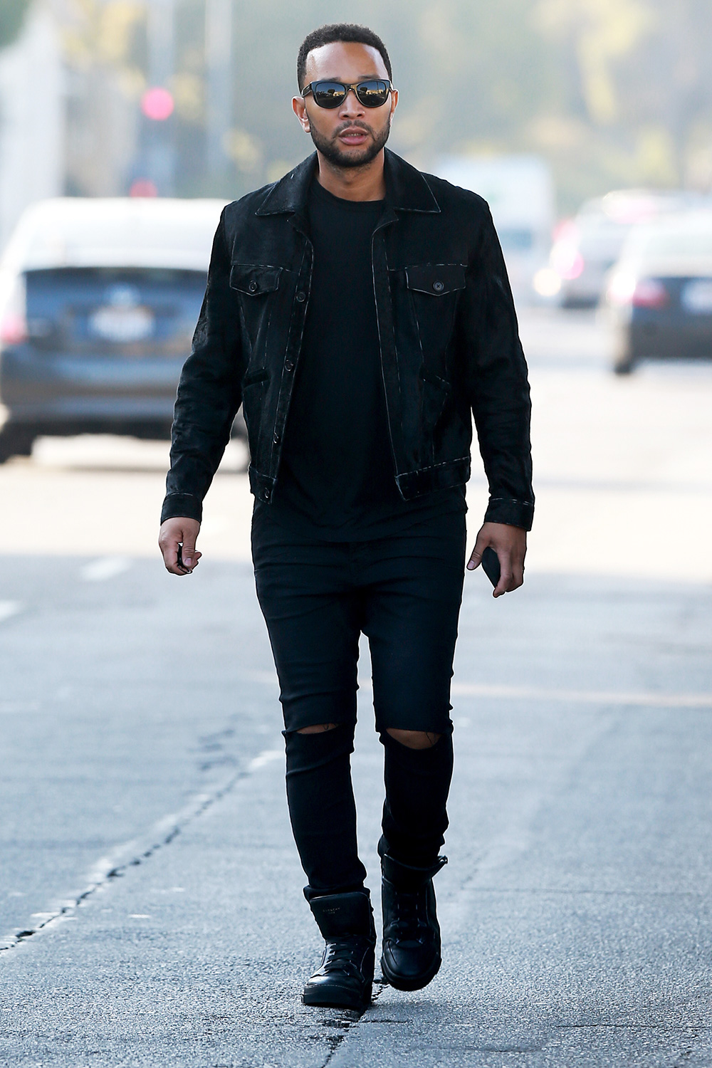 John Legend is pictured stepping out in Los Angeles