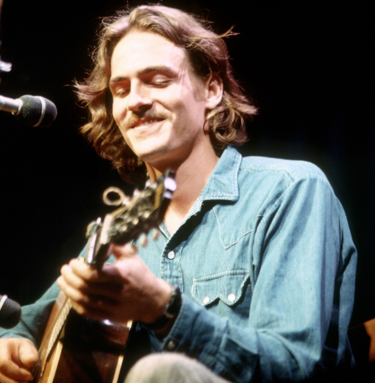 James Taylor performs onstage at the Mariposa Folk Festival in 1970 in Orillia, Ontario, Canada