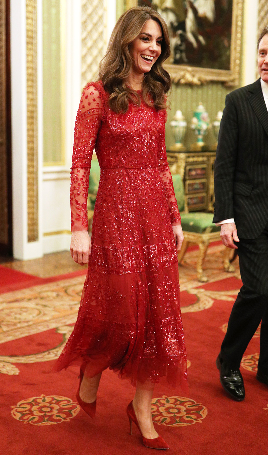 Catherine, Duchess of Cambridge walks through to the State Room with the Master of the Household during a reception to mark the UK-Africa Investment Summit at Buckingham Palace on January 20, 2020 in London, England