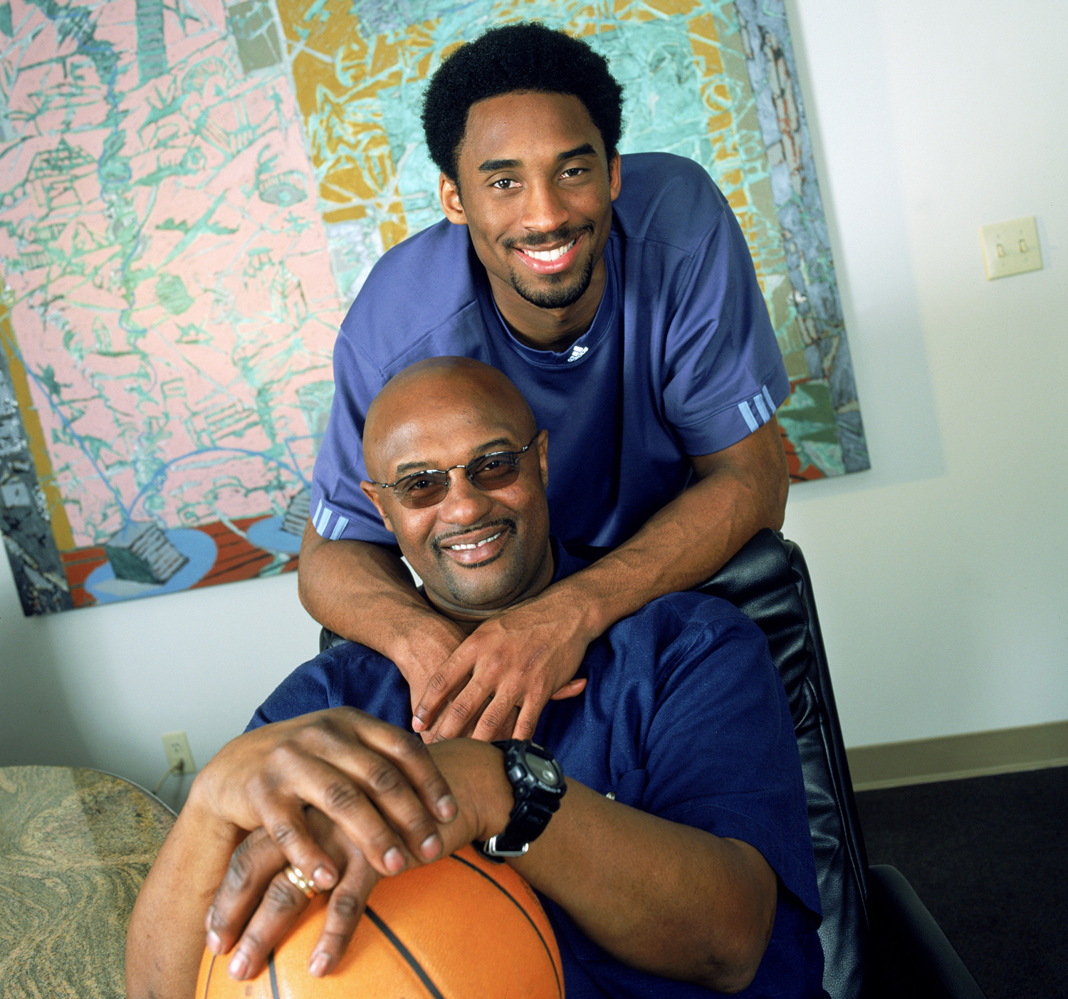 "Kobe Bryant #8 of the Los Angeles Lakers poses for a portrait with his father, former NBA player Joe ""Jellybean"" Bryant"