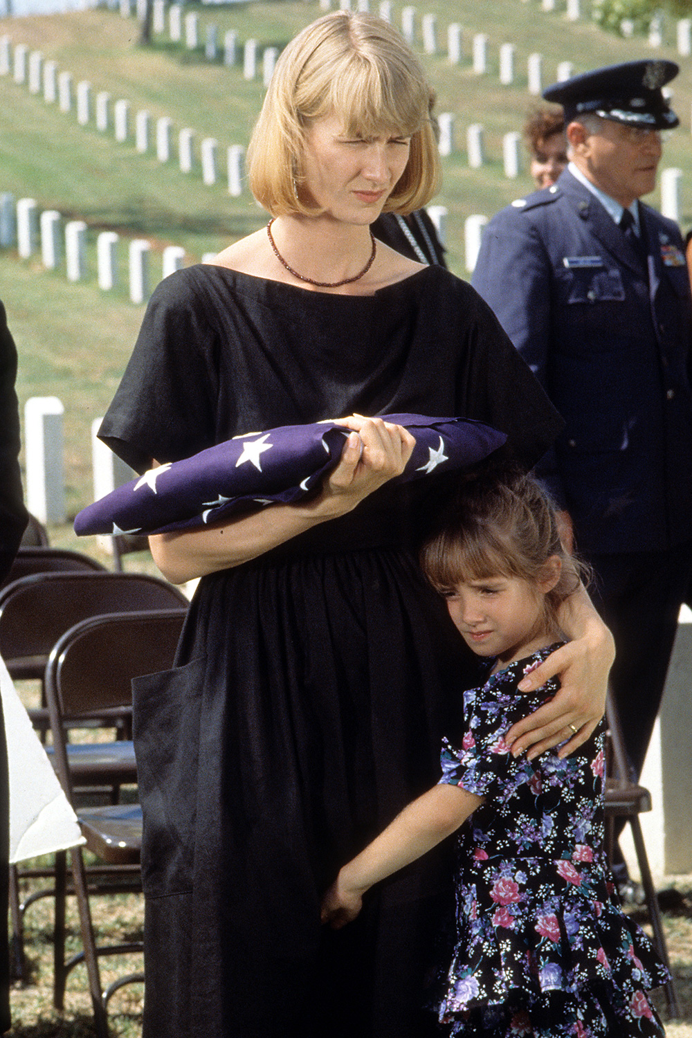 Laura Dern with child at funeral in a scene from the TV Movie 'Afterburn', 1992