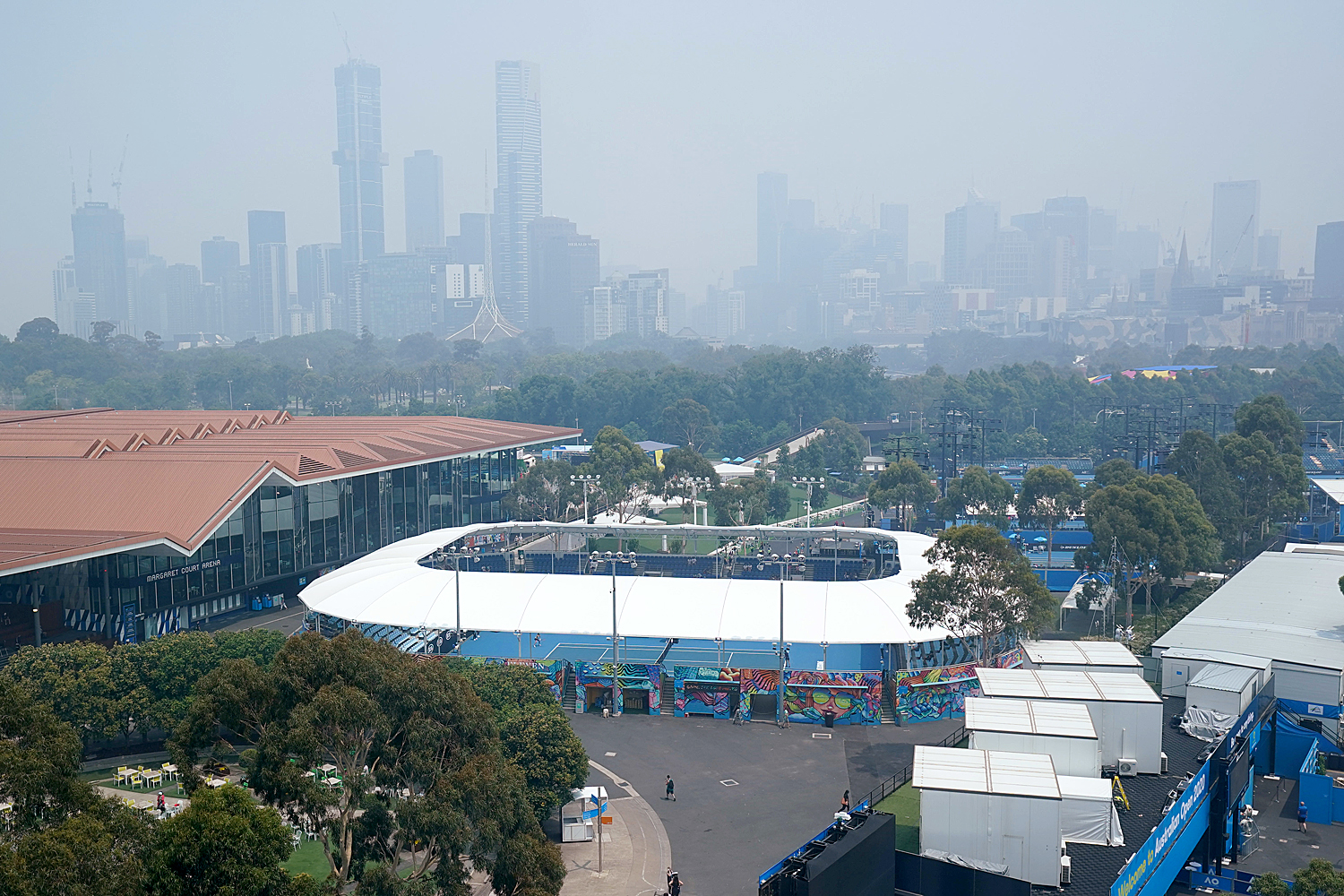 Haze covers the skyline during practice sessions at the Australian Open at Melbourne Park