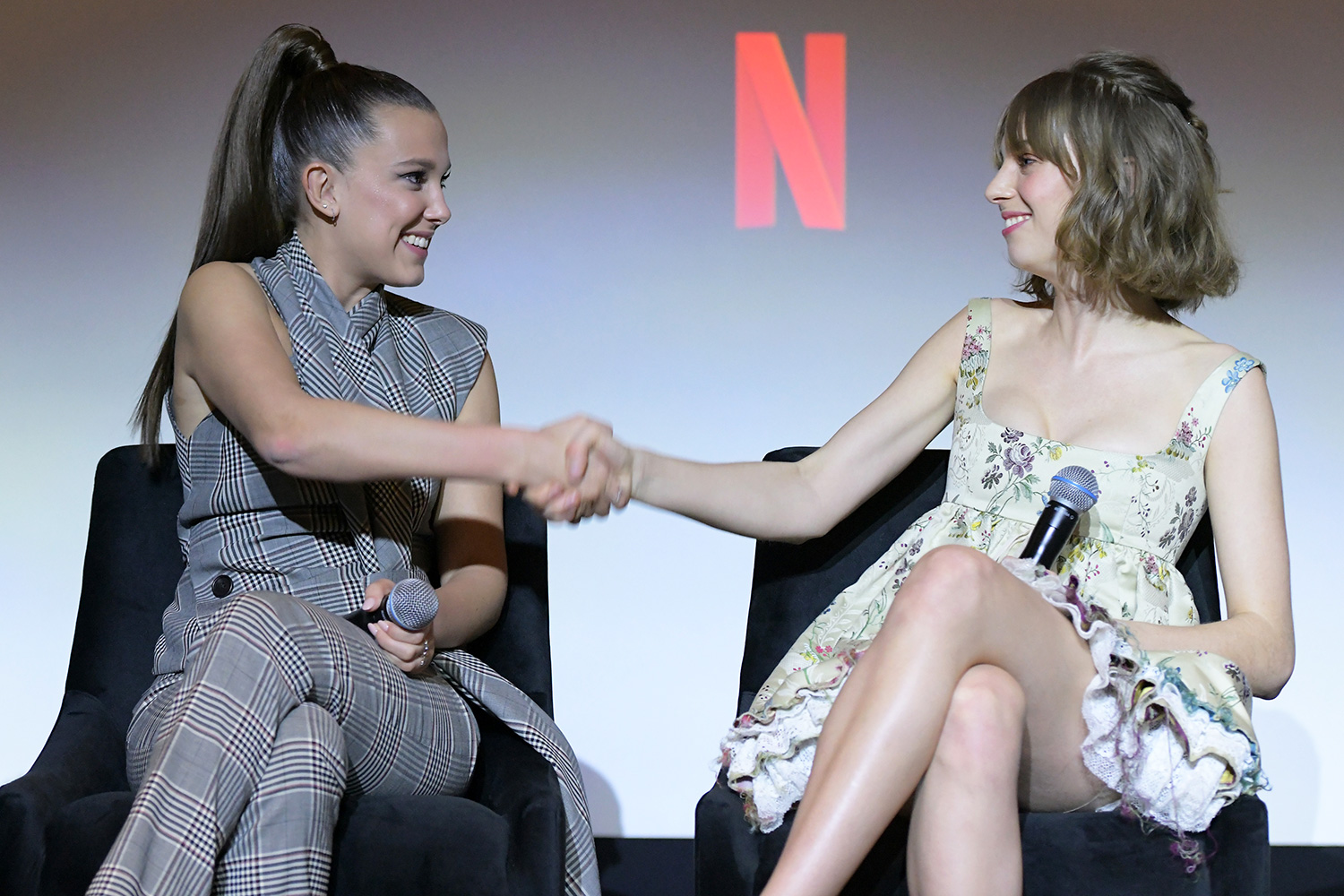 """Millie Bobby Brown and Maya Hawke speak onstage during Netflix's """"Stranger Things"""" Q&A and Reception at Pacific Design Center on January 11, 2020 in West Hollywood, California"""