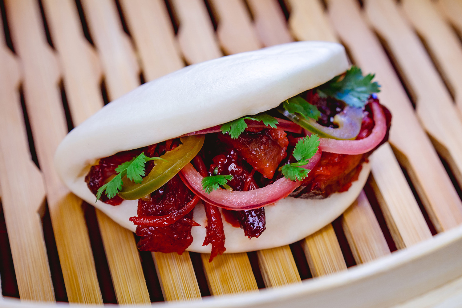 This char siu pork bao with barbecued pork, pickled red onions and jalapeño can be found at Disney California Adventure Park as Disneyland Resort celebrates the Year of the Mouse this Lunar New Year, Jan. 17 through Feb. 9, 2020