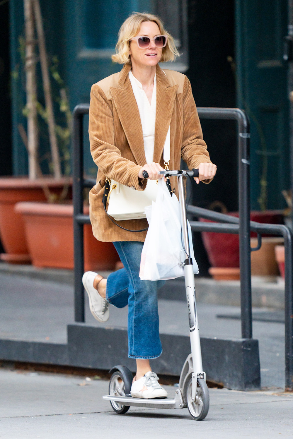 Naomi Watts out doing errands on a scooter in New York City