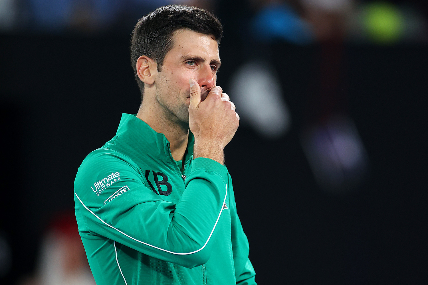 Novak Djokovic of Serbia tears up as he talks about Kobe Bryant after winning his Men's Singles Quarterfinals match against Milos Raonic of Canada on day nine of the 2020 Australian Open at Melbourne Park on January 28, 2020 in Melbourne, Australia