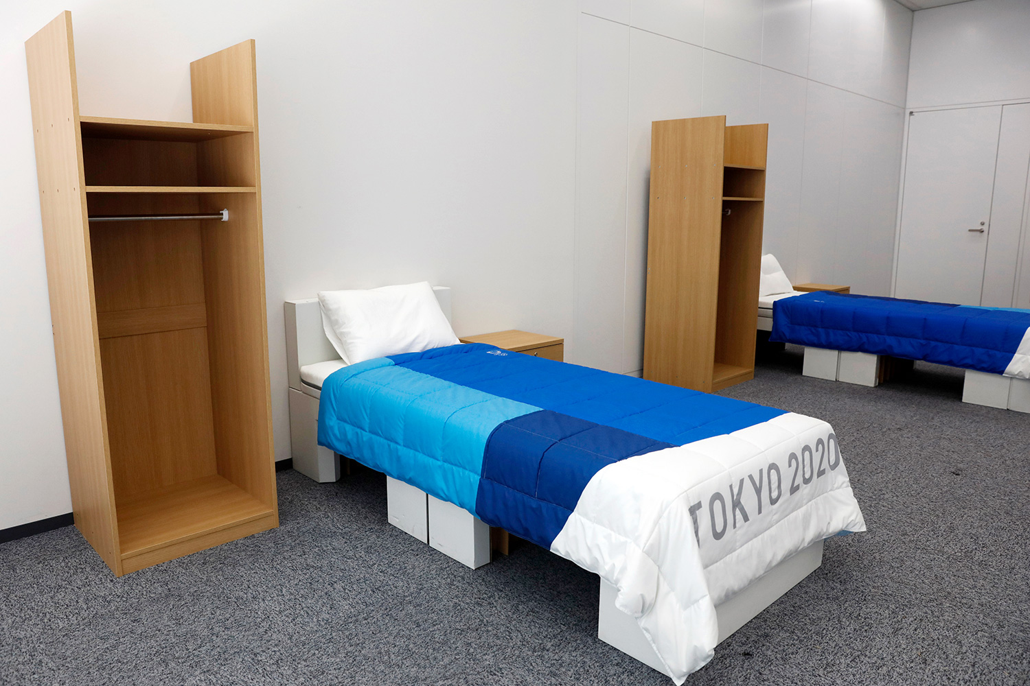 Two sets of bedroom furniture, including cardboard beds, for the Tokyo 2020 Olympic and Paralympic Villages are shown in a display room, in Tokyo. Tokyo Olympic athletes beware - particularly larger ones. The single bed frames in the Athletes Village at this year's Olympics will be made of cardboard. The single bed frames will be recycled into paper products after the games. The mattress components - the mattress are not made of cardboard - will be recycled into plastic products Olympics Cardboard Beds, Tokyo, Japan - 09 Jan 2020