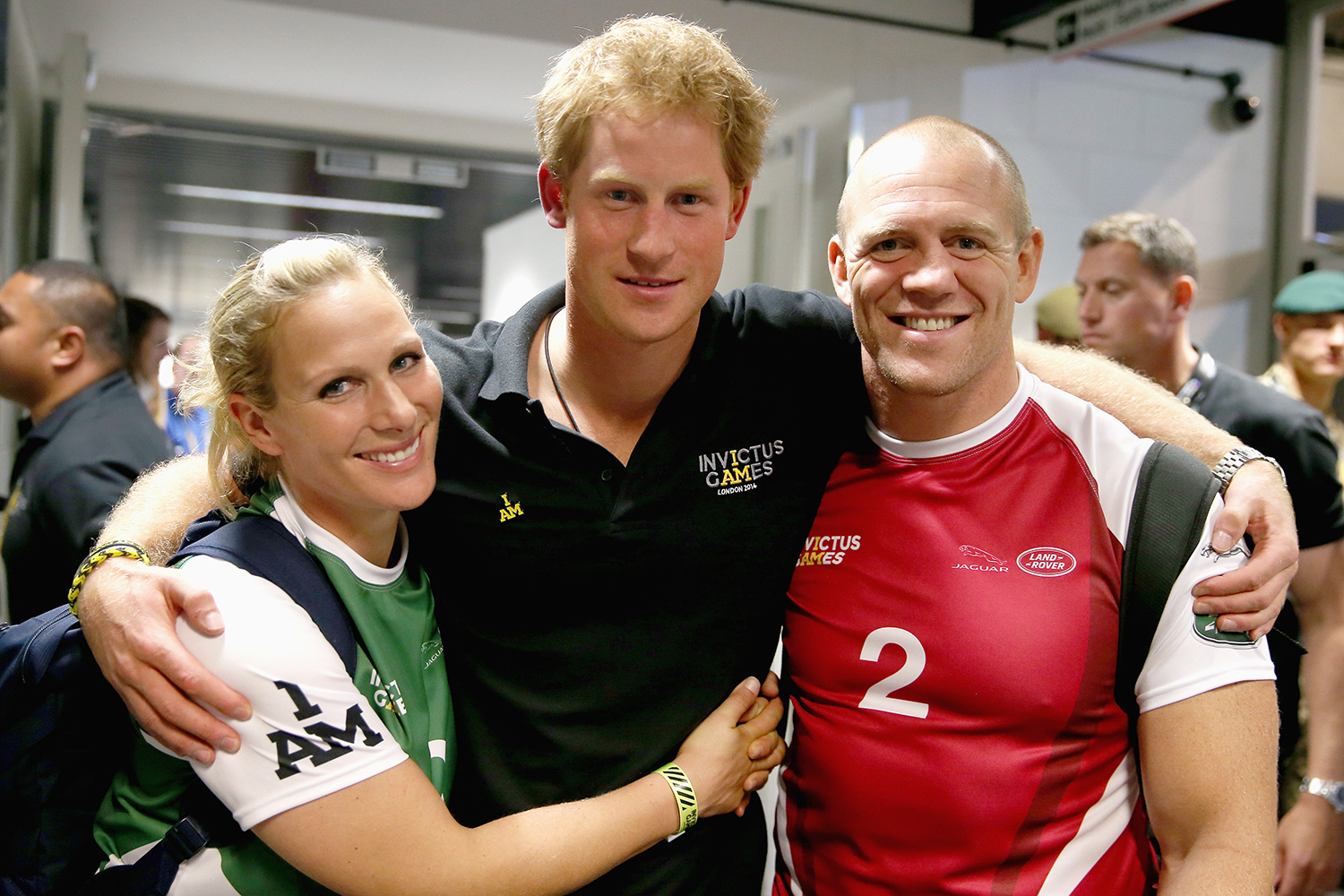 Prince Harry, Zara Phillips and Mike Tindall pose for a photograph after competing in an Exhibition wheelchair rugby match at the Copper Box ahead of tonight's exhibition match as part of the Invictus Games at Queen Elizabeth park on September 12, 2014 in London, England
