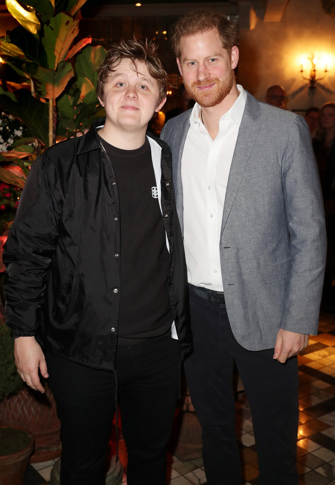 Lewis Capaldi poses with Prince Harry, Duke of Sussex as Sentebale held an event on January 19, 2020
