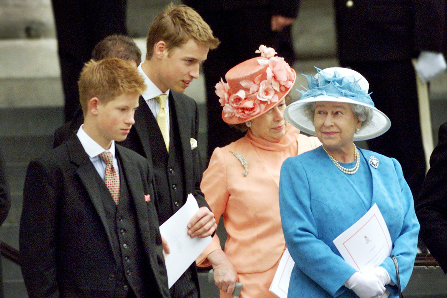 Britain's Queen Elizabeth (R) waits on the steps of St. Paul's Cathedral with her grandsons Prince Harry (L), Prince William (2nd L) and Princess Margaret (2nd R) after attending a national service of thanksgiving in celebration of The Queen Mother's forthcoming 100th birthday in London 11 July 2000