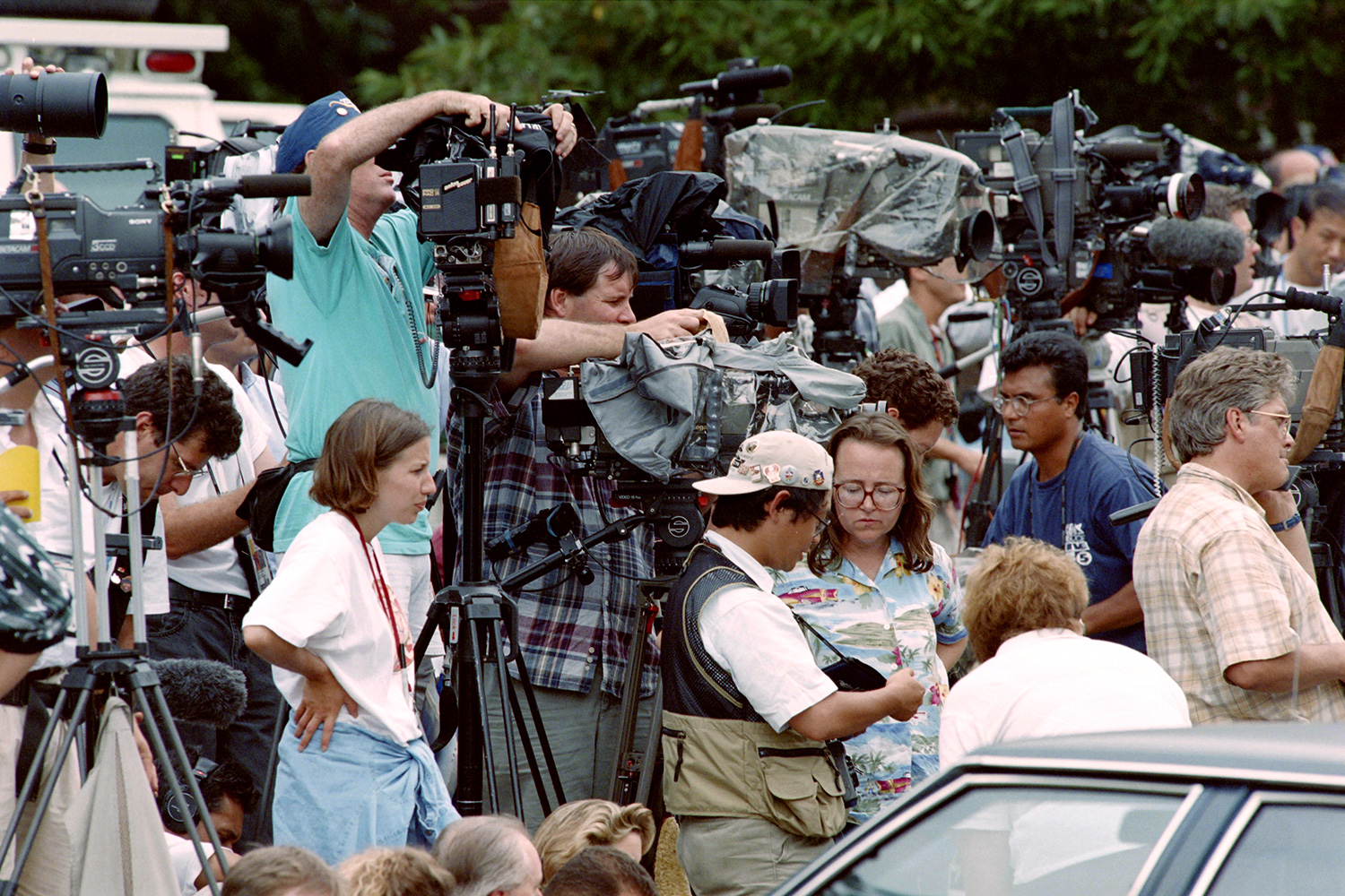 Photographers, television crews and reporters set up on July 31, 1996, in Atlanta, outside the apartment of Richard Jewell