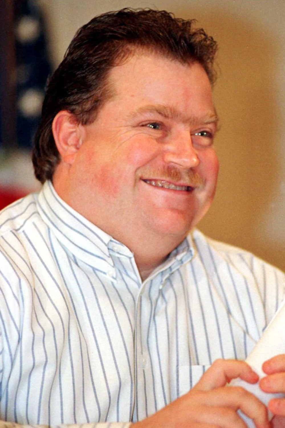 Richard Jewell smiles during a press conference 28 October in Atlanta, Ga. Jewell was cleared as a suspect in the July 27 bombing of Centennial Olympic Park, three months after the FBI announced that he was their prime suspect