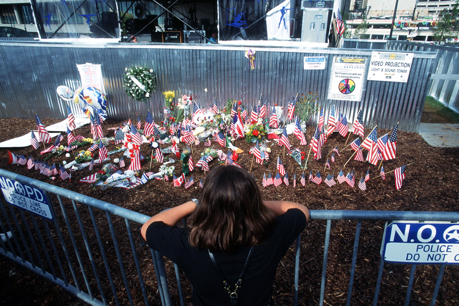 A woman stands in front of a shrine to the victims of the bomb explosion at the AT&T Pavillion in the Centennial Olympic Park during the 1996 Centennial Olympic Games July 27, 1996 in Atlanta, Georgia. Eric Robert Rudolph, accused of planting the bomb that killed two people and injured scores, has been arrested May 31, 2003 in North Carolina