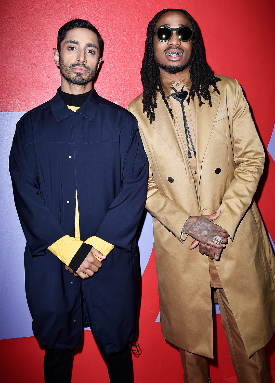 Riz Ahmed (L) and Quavo (R) attend the Prada Show during Milan Menswear Fashion Week Fall/Winter 2020/21 on January 12, 2020 in Milan, Italy.